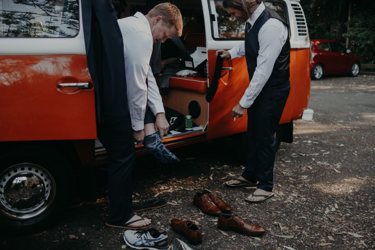 groom putting on shoes in kombi