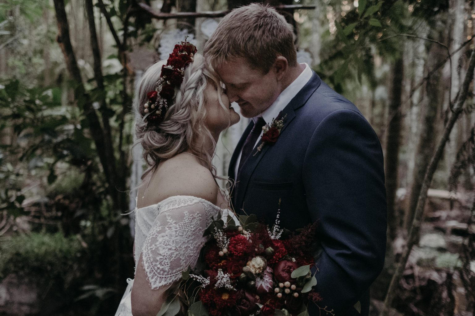 bride and groom at forest alter elopement ceremony kiss