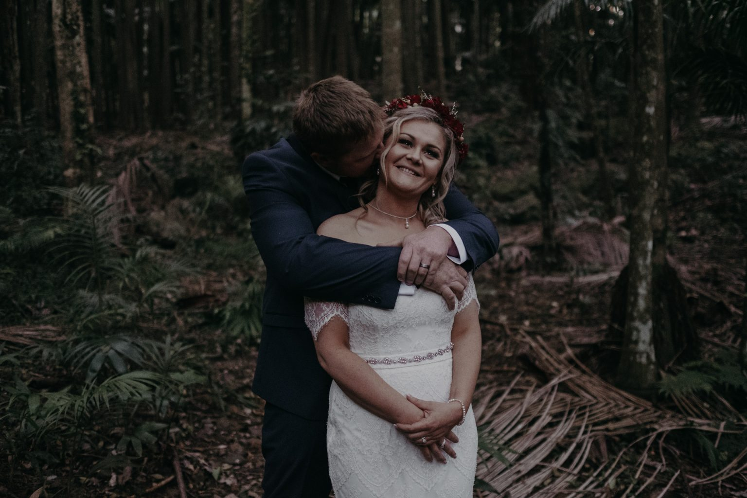 bride groom kiss in forest