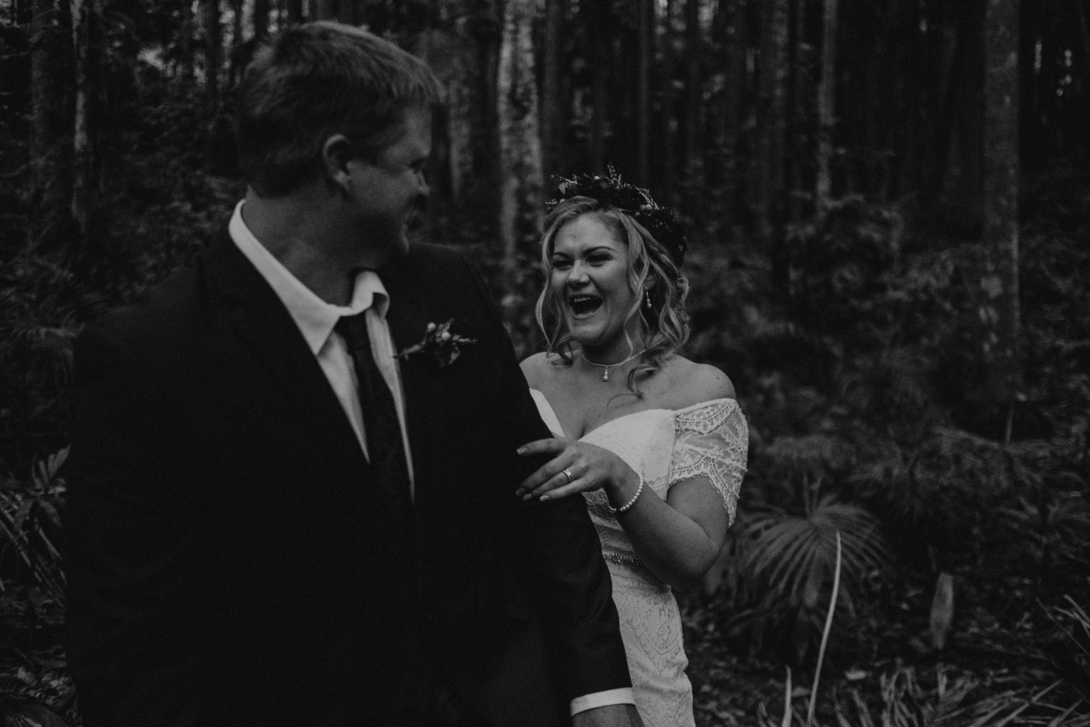 bride laughing in forest