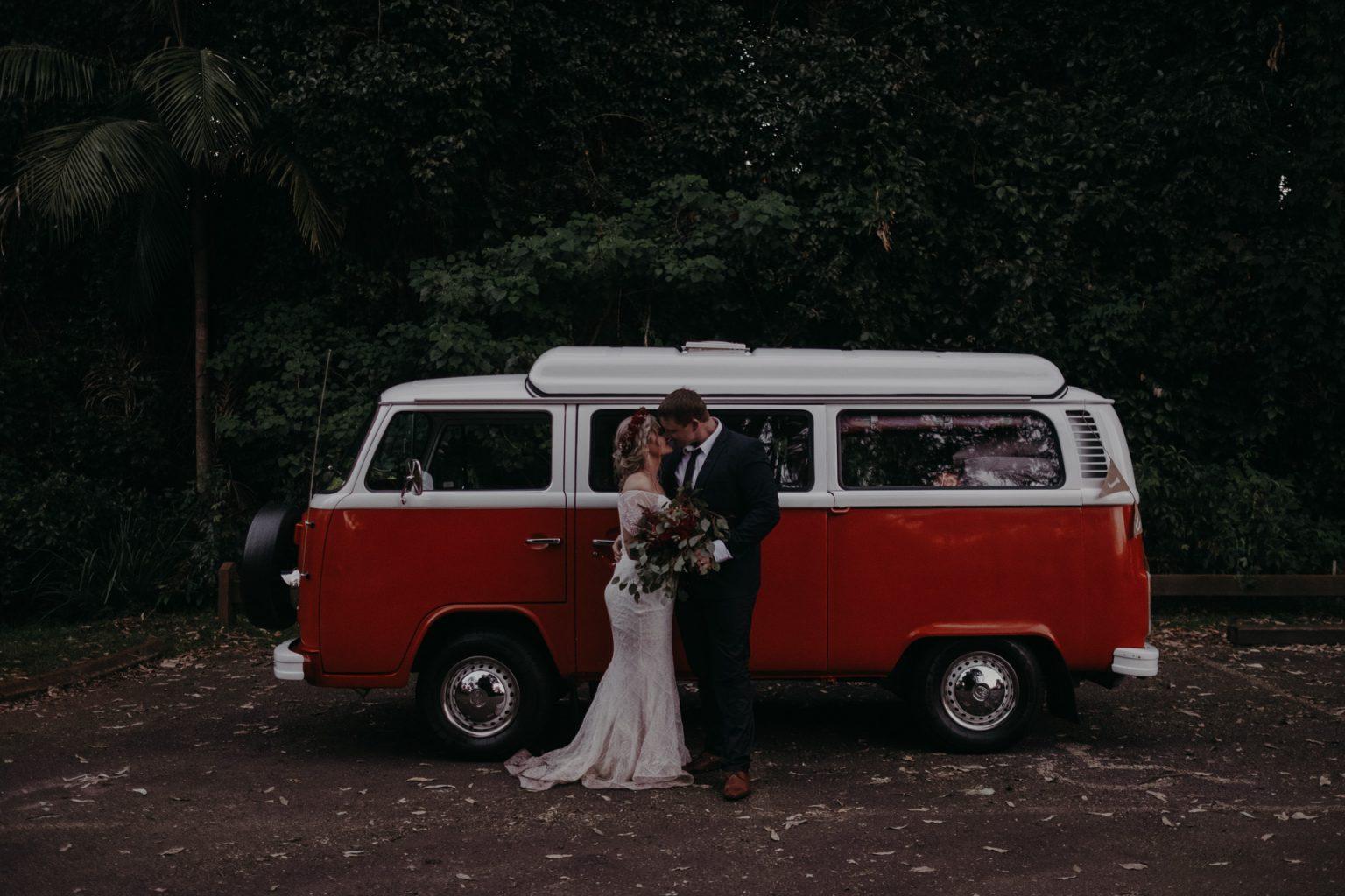 bride and groom wet with kombi