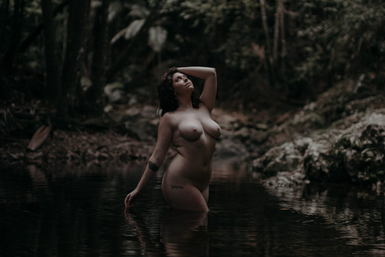 naked woman in forest pool Currumbin