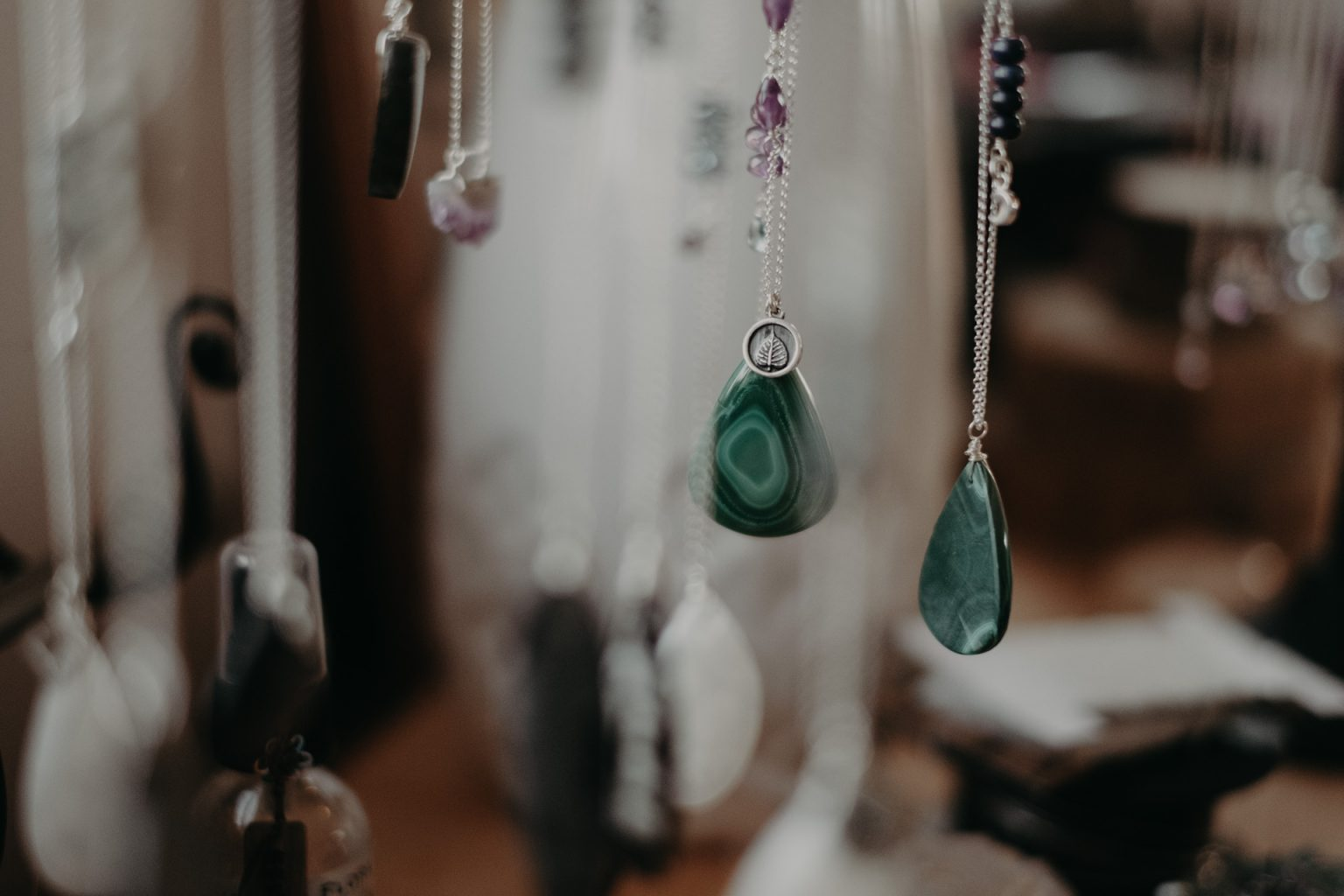 hanging necklaces with gems