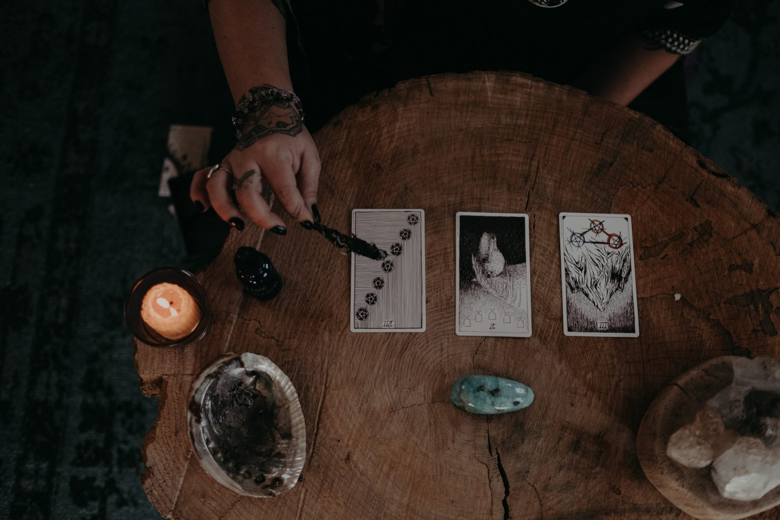 woman with tarot cards on table