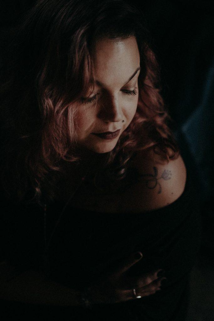 portrait of woman in shadow brisbane bare shoulder