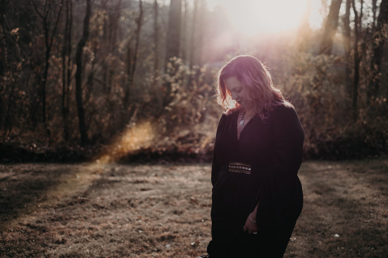 portrait of woman in woods sunlight