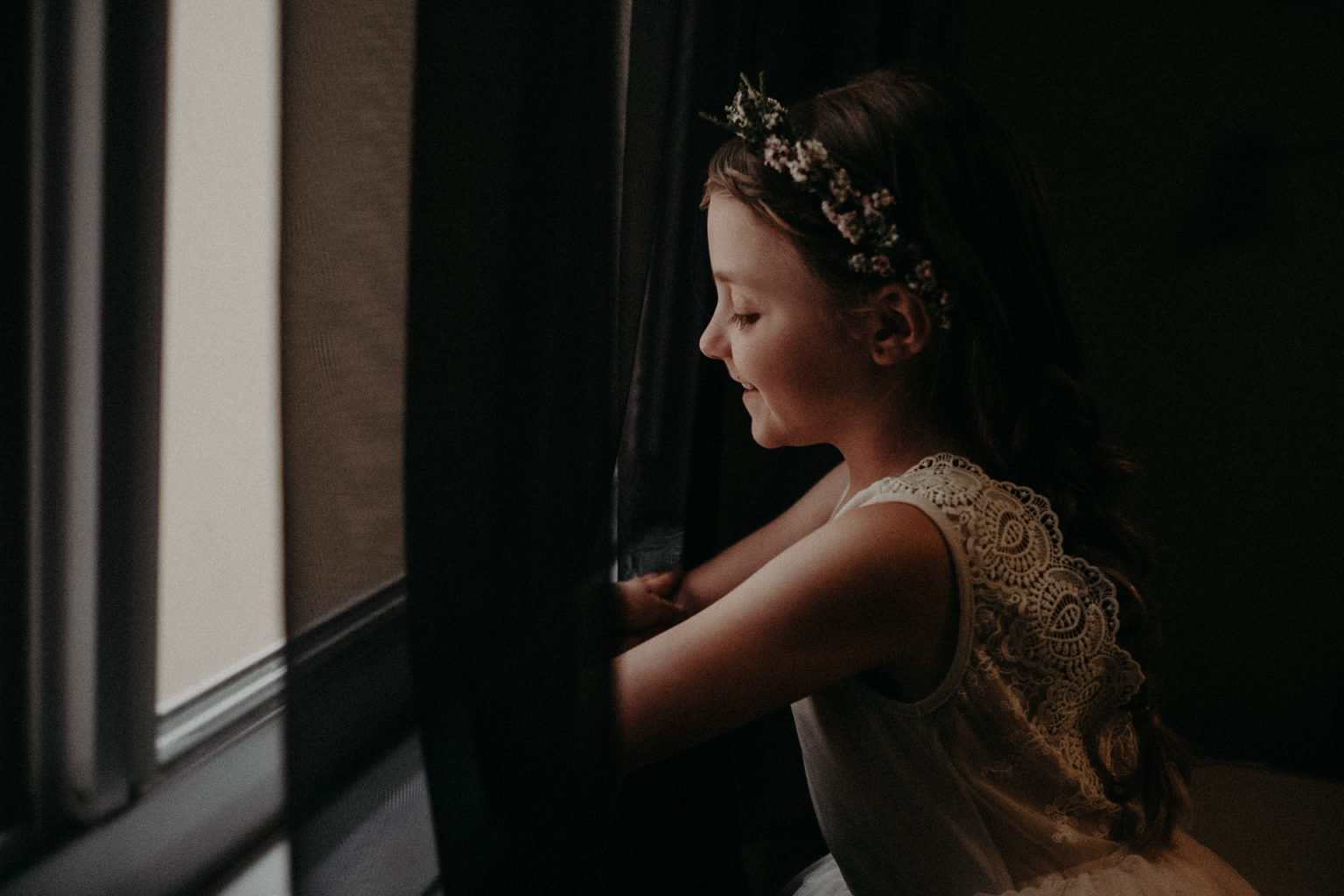 bridesmaid looking out window