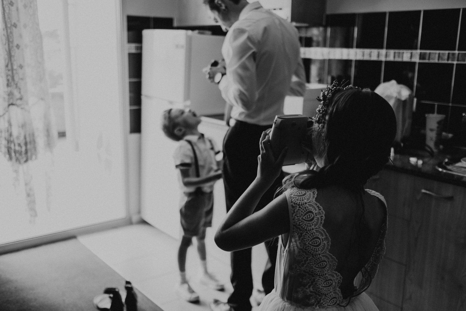 girl taking polaroid