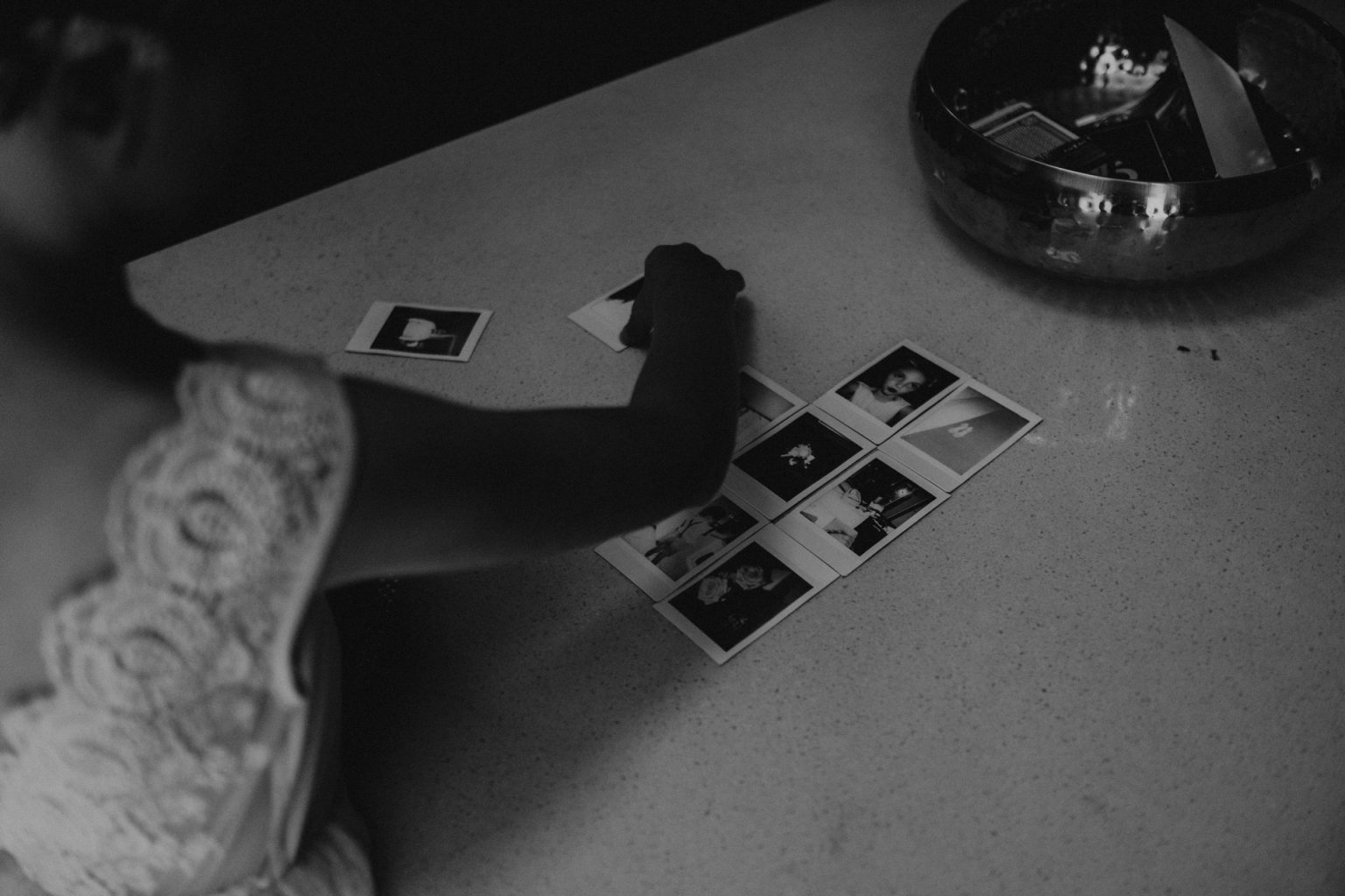kids playing with polaroids on table