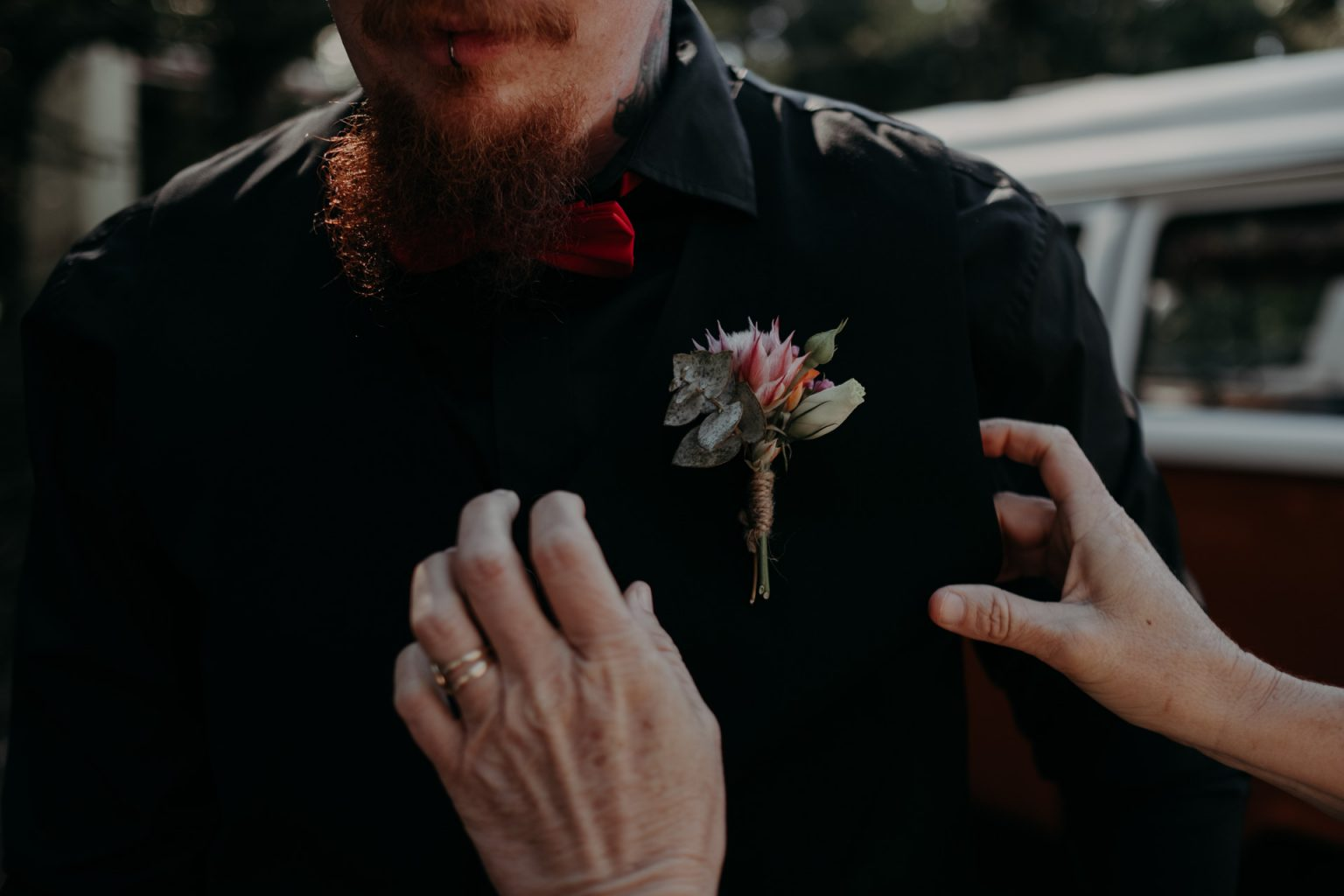 man with flower boutonniere