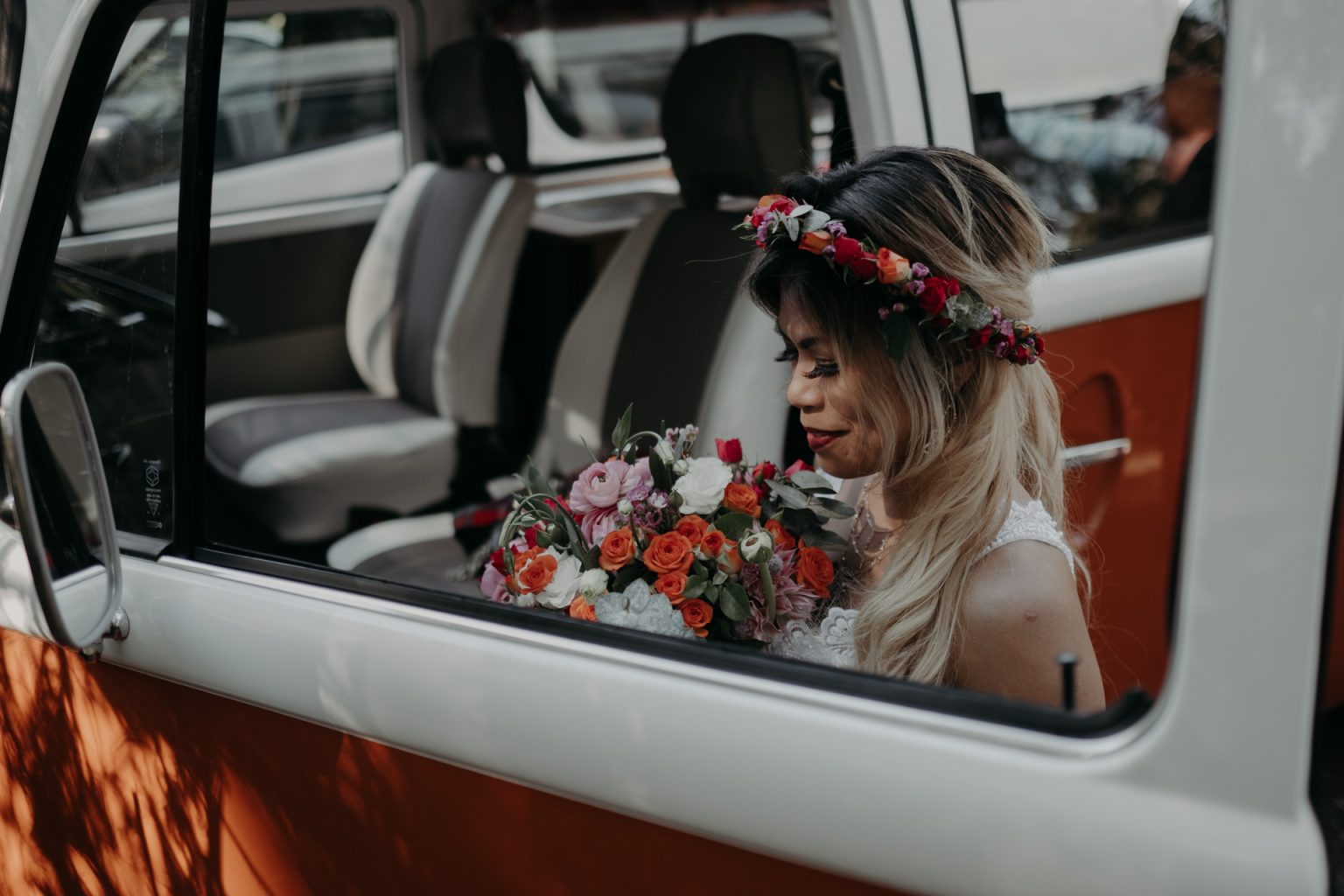 bride with flower crown and bouquet with kombi