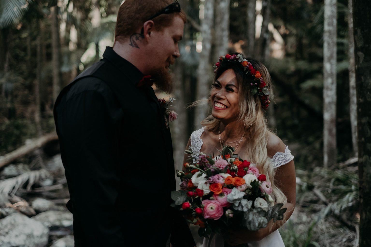 bride and groom eloping in forest mt tamborine