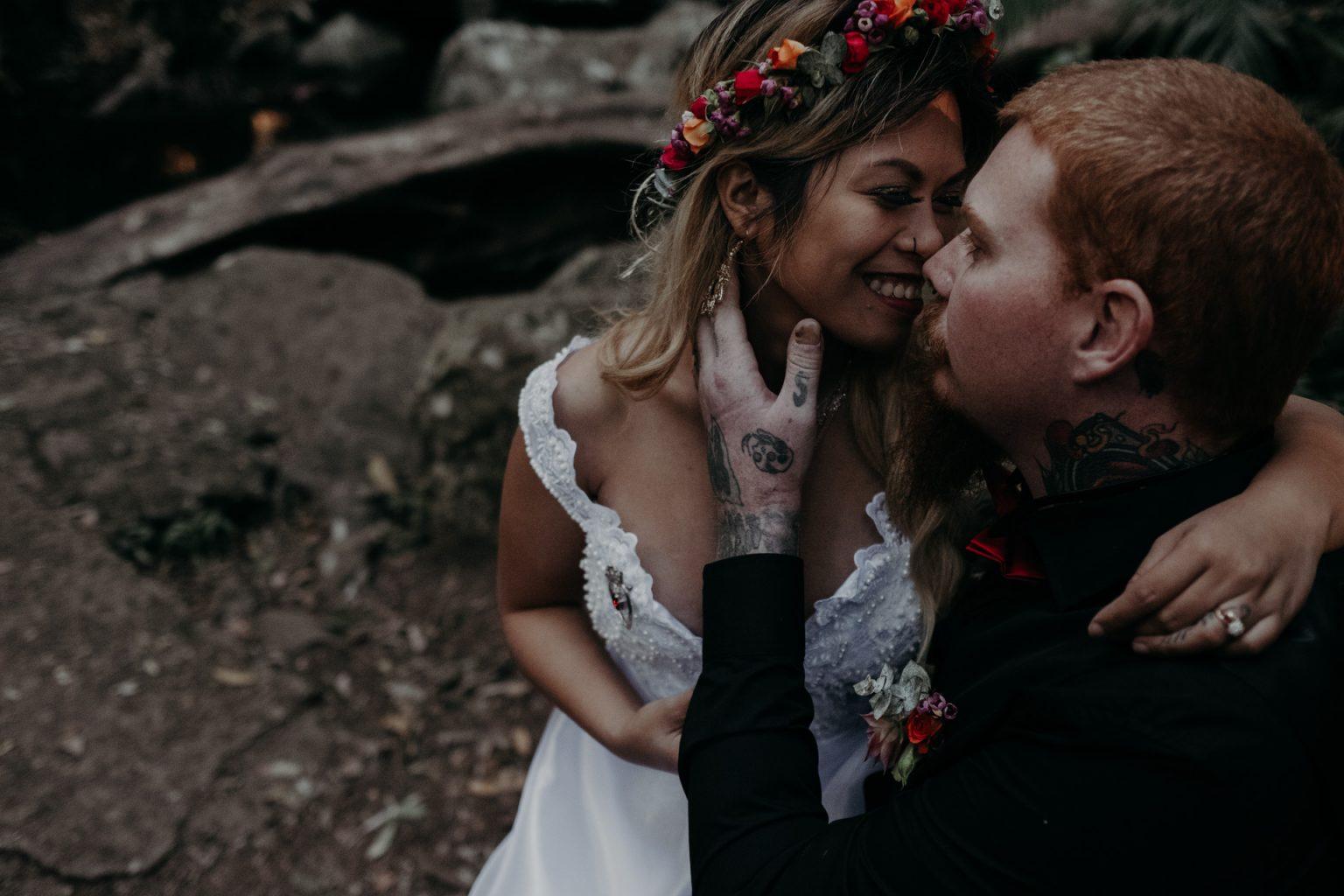 bride and groom kiss forest elopement mt tamborine