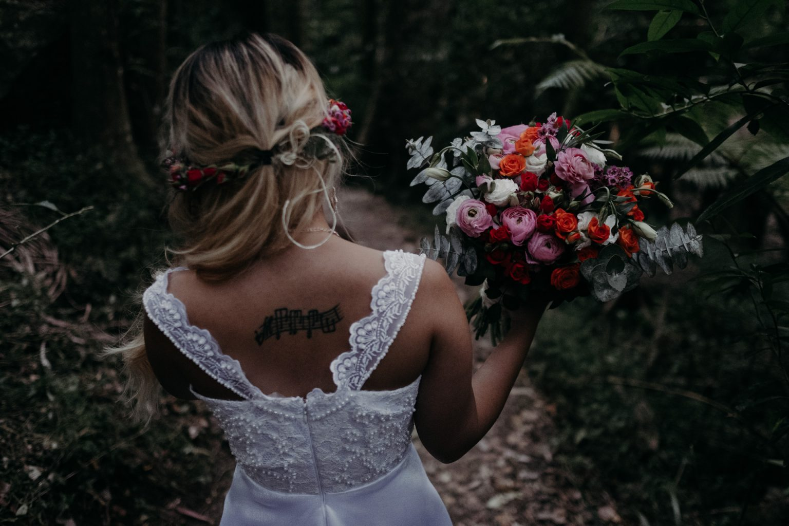 bride with flower crown and bouquet