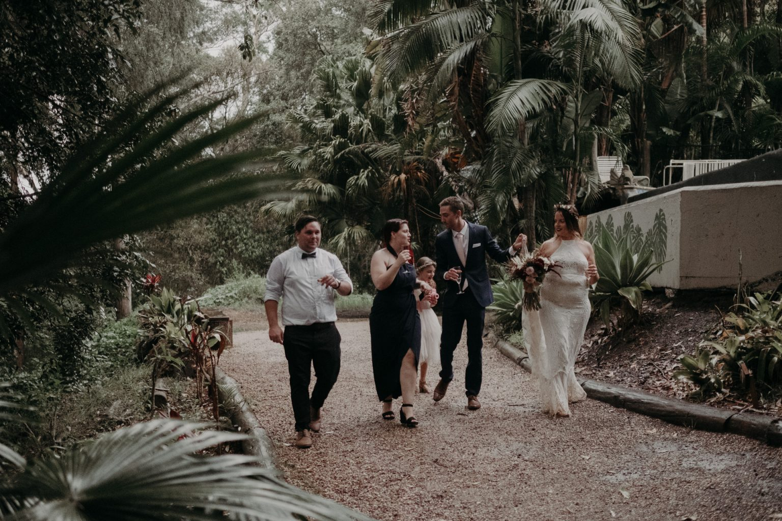 bridal party walking with champagne