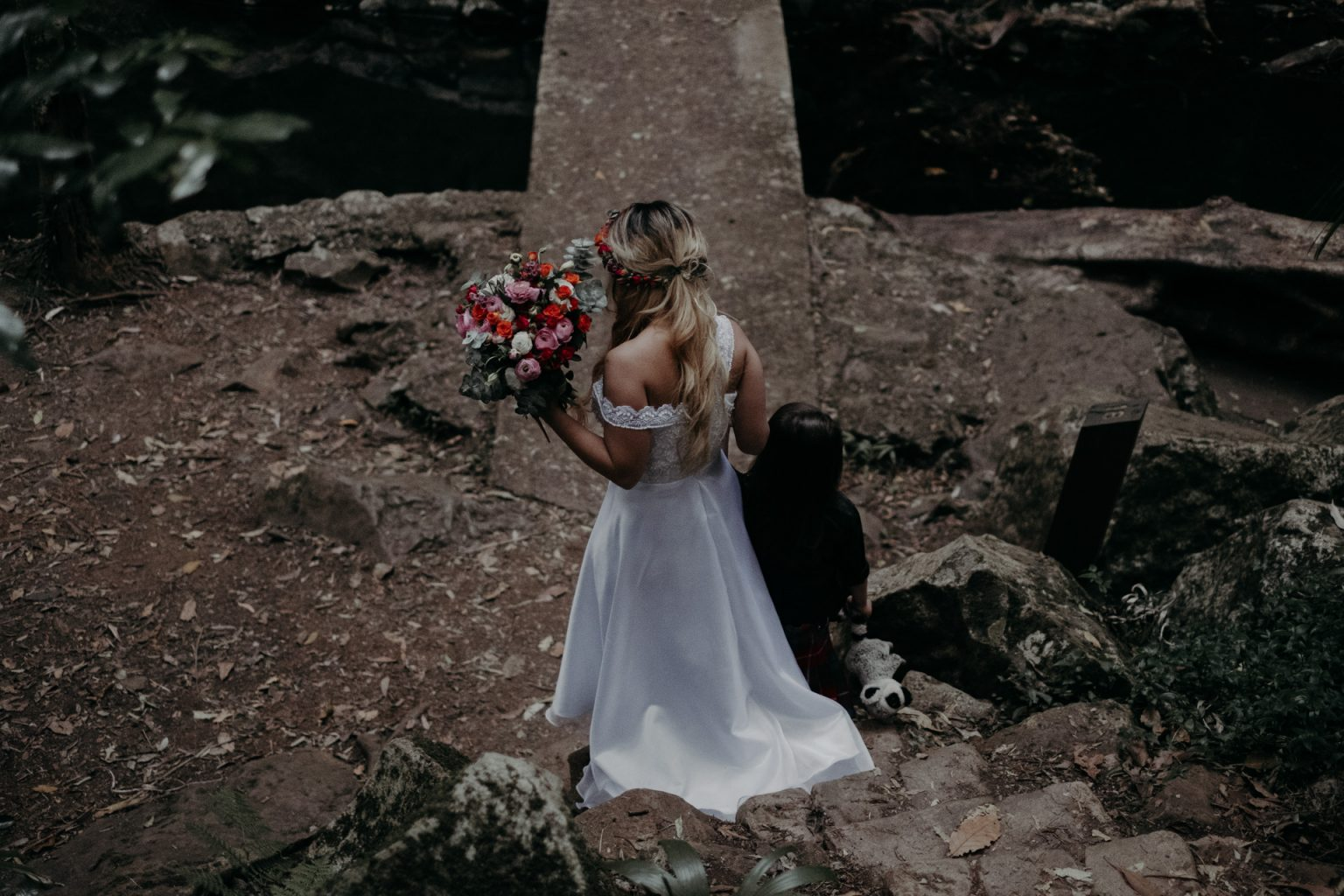 bride with flower crown and bouquet with son