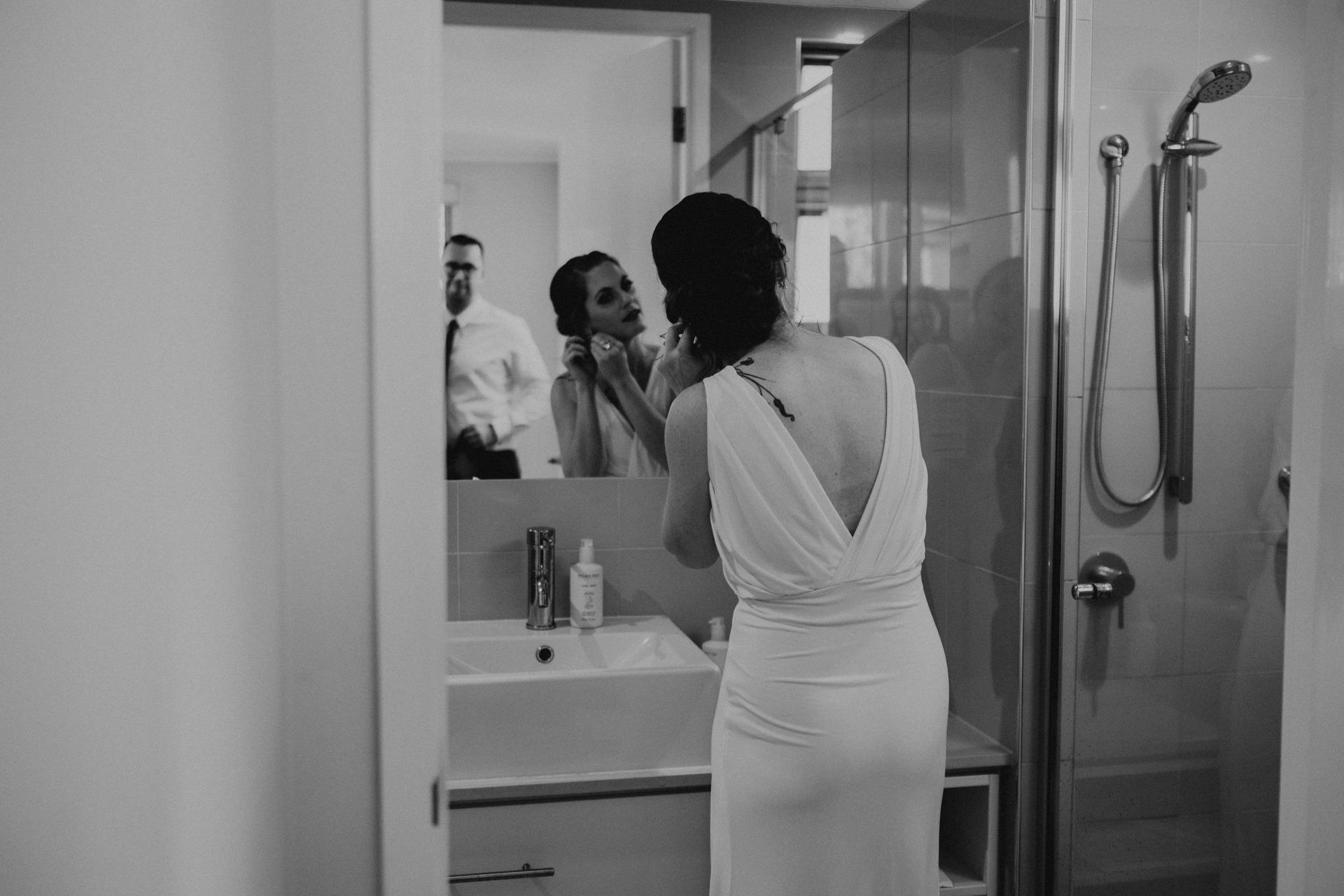 bride getting ready in mirror