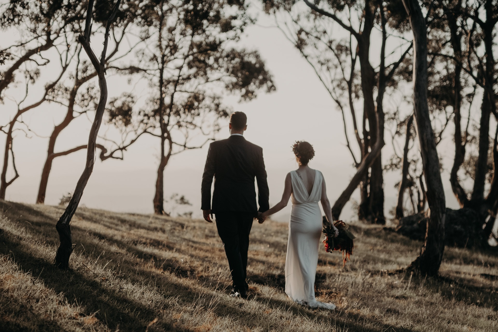 bride and groom walking to mountain look out oreillys rainforest retreat Gold Coast