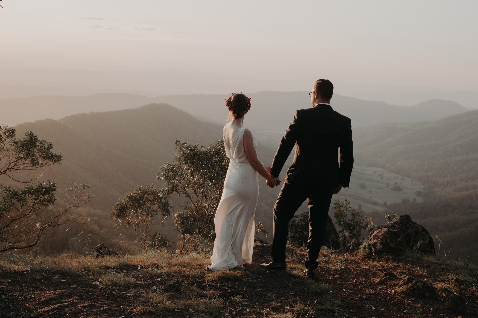 bride and groom sunset mountain look out oreillys