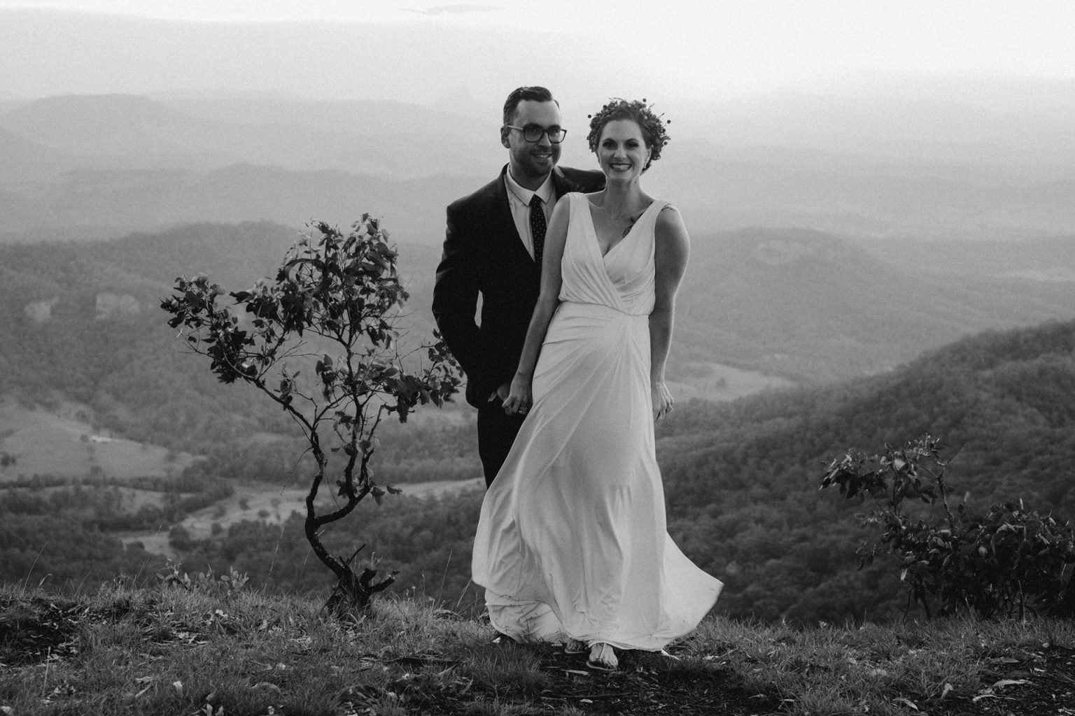 bride and groom laughing to mountain look out oreillys