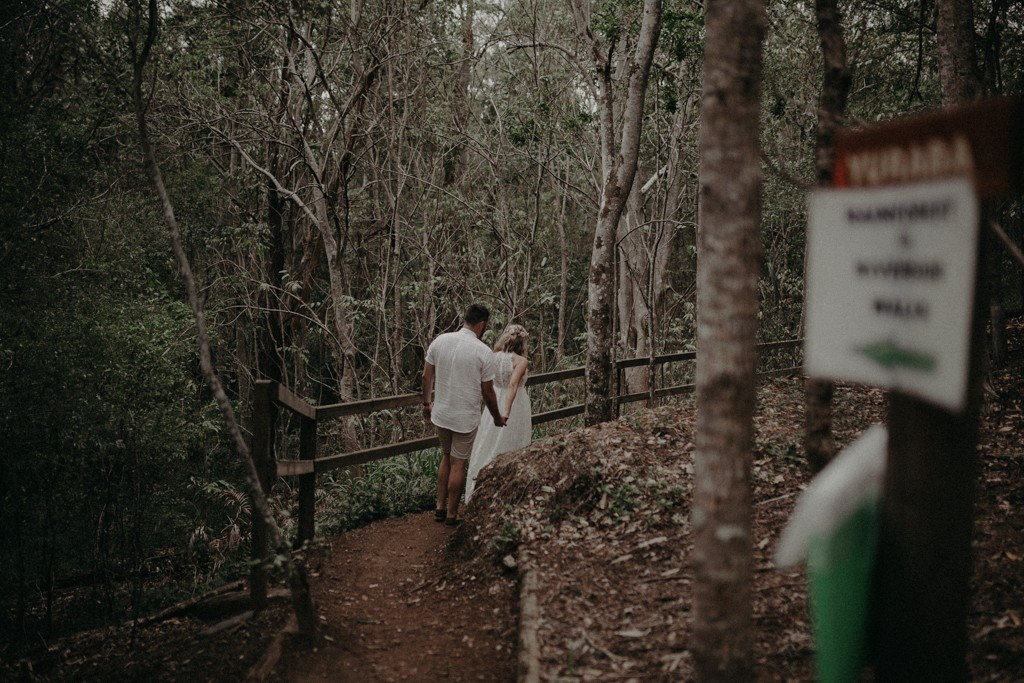 bride and groom walking  at Kumbartcho Sanctuary at Eatons Hill