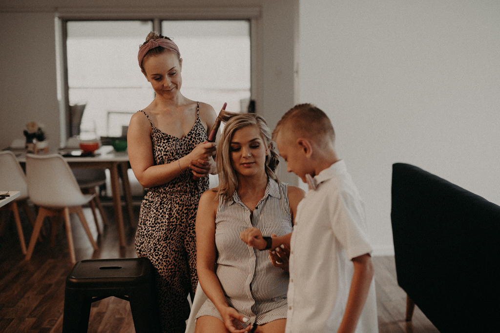 bride with hairdresser and boy