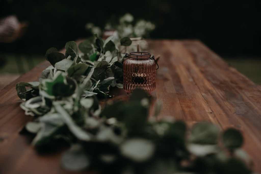 decorative brand and candle holder on table at garden wedding Eatons hill Brisbane