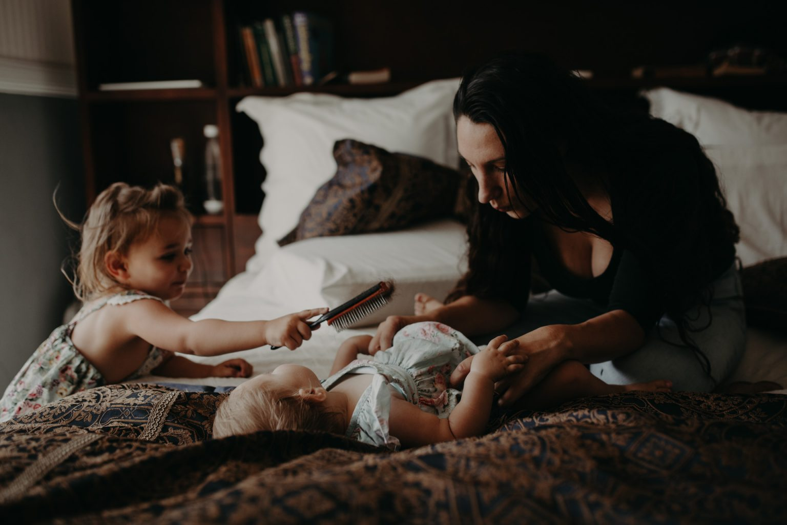 Brisbane mother and toddlers on bed