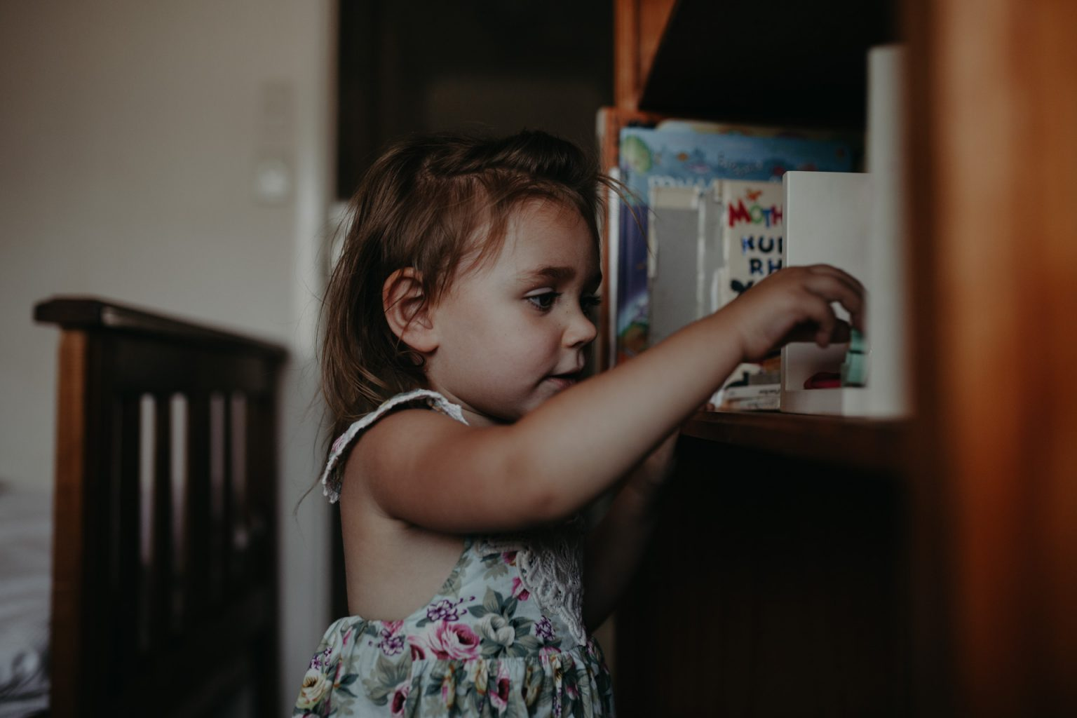 Toddler and bookcase