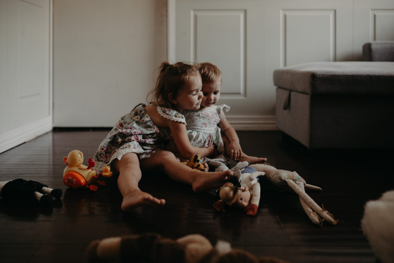 two Brisbane toddlers cuddling