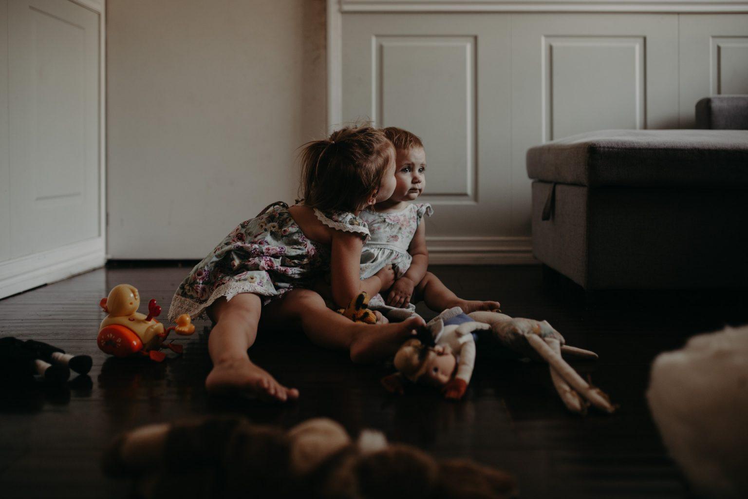 two Brisbane toddlers cuddling