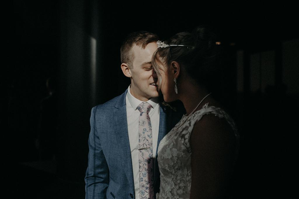 Bride and groom by window at at Brisbane Registry RBDM