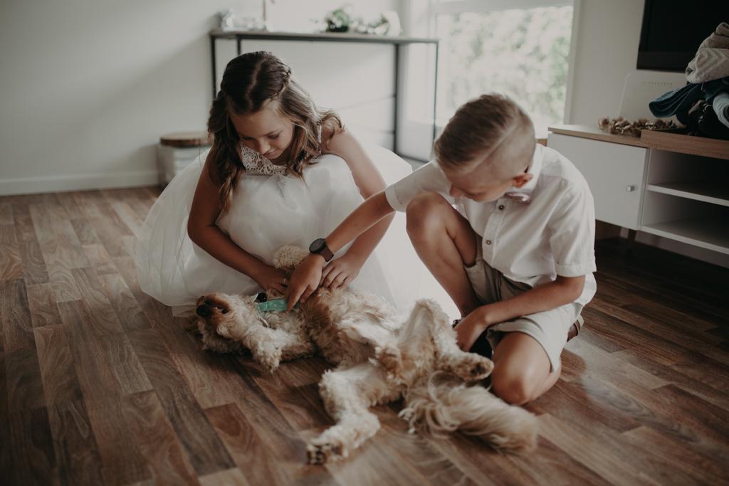 girl and boy with dog