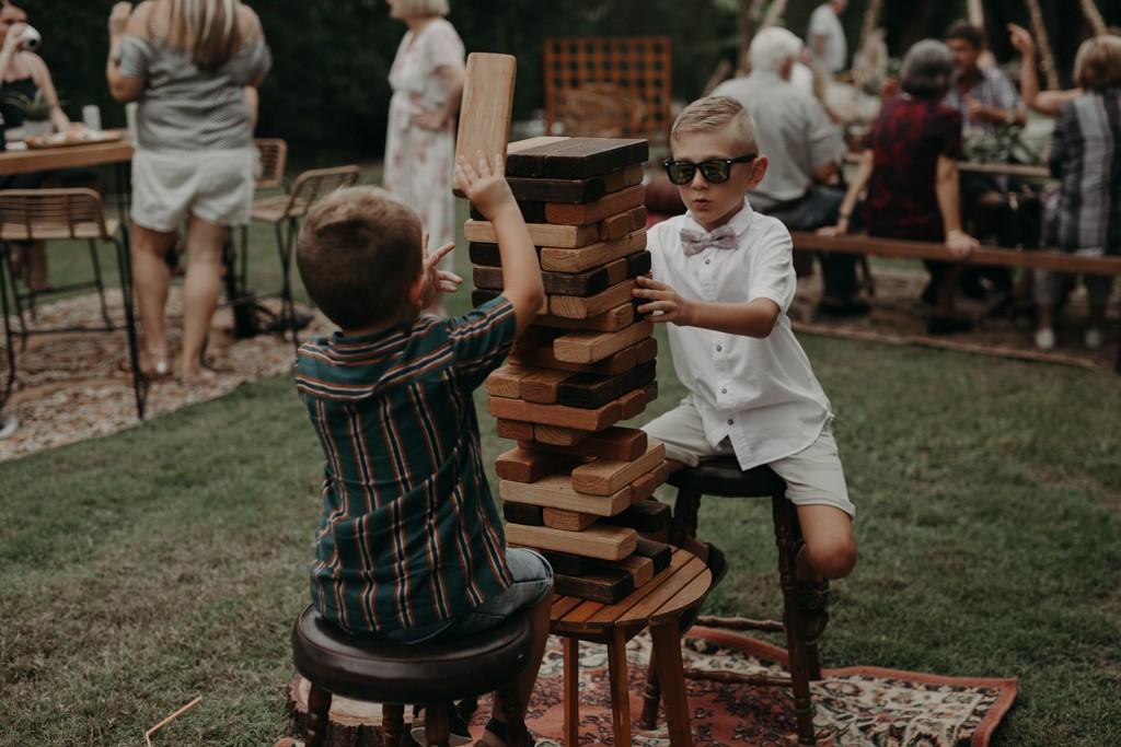 two boys playing garden jenga at garden wedding Eatons hill Brisbane