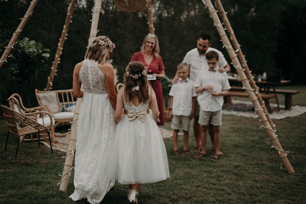 bride and daughter walking down aisle at garden wedding Eatons hill Brisbane