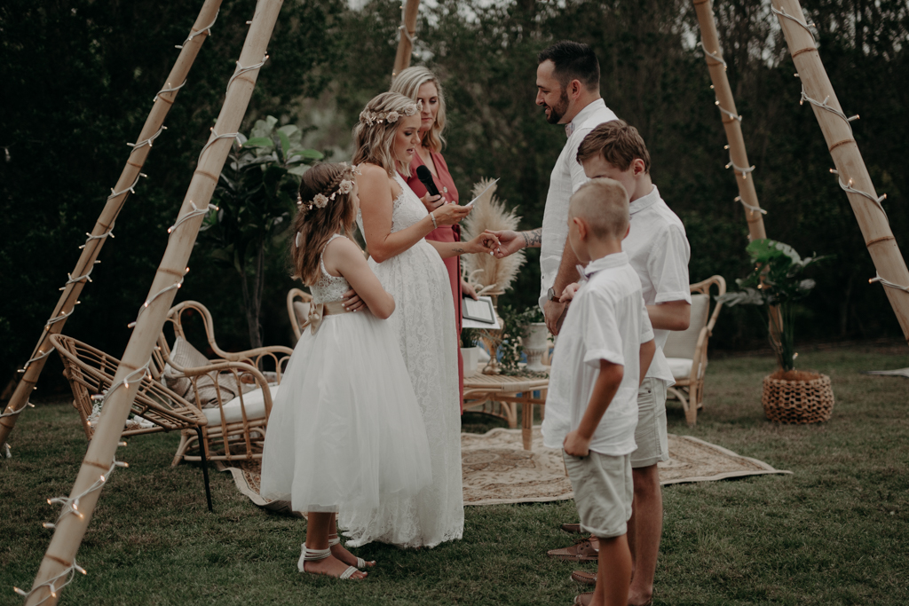 bride and groom with children  at garden wedding Eatons hill Brisbane