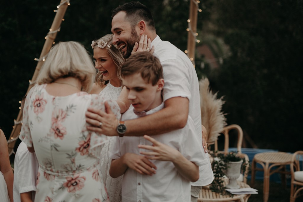 family laughing  at garden wedding Eatons hill Brisbane