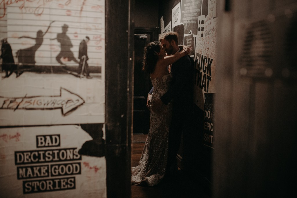 bride and groom kissing at Alfred and constance bar fortitude valley