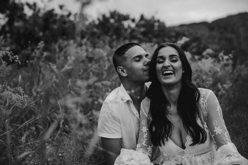 tattooed man and woman wearing lace in field