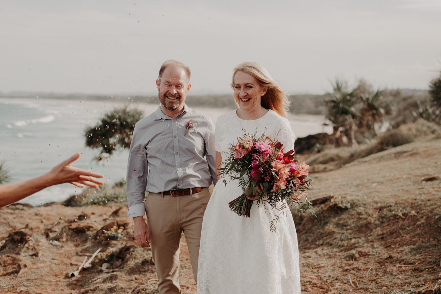bride and groom clifftop elopement confetti