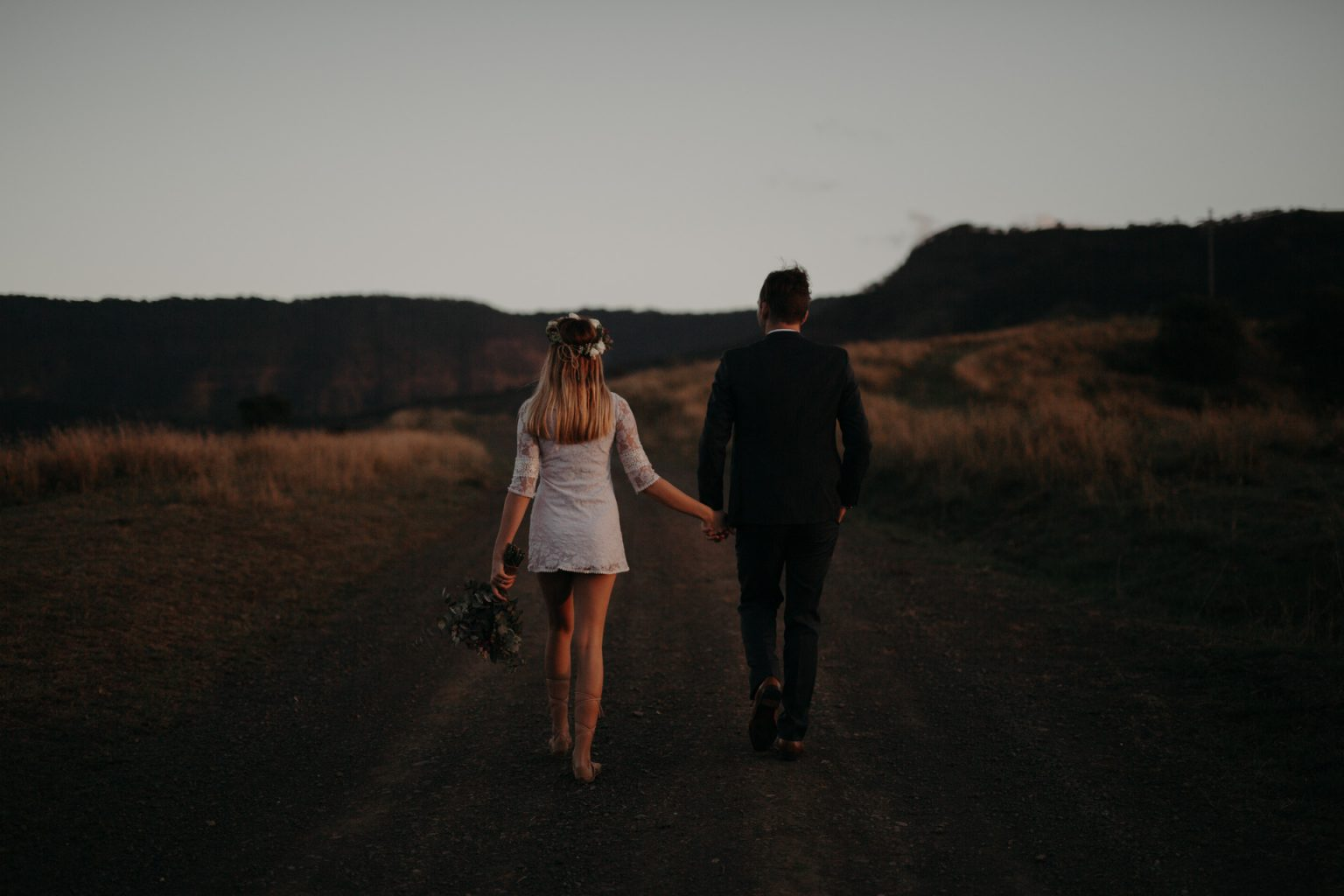 bride and groom on country road long grass scenic rim