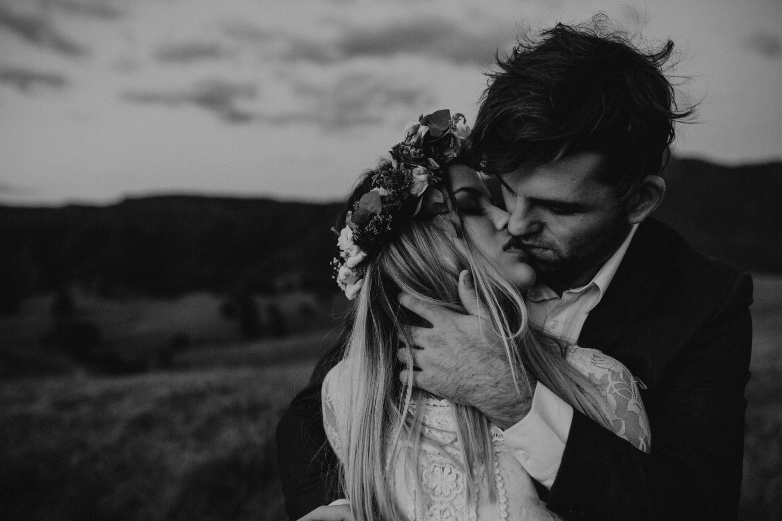 groom holding bride country lane laughing scenic rim passionate kiss