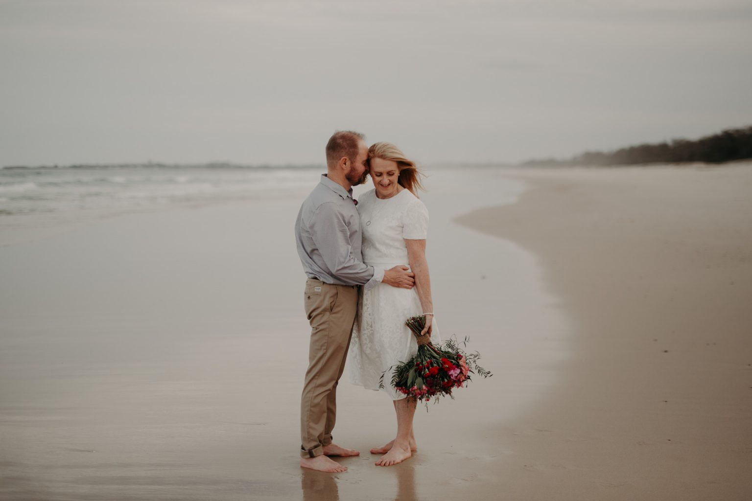bride and groom on beach at Fingal head