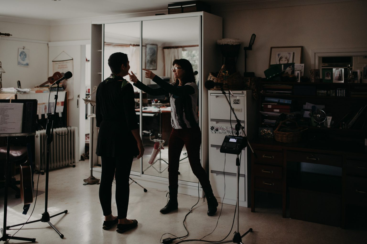 singing teacher and student in brisbane music studio microphone