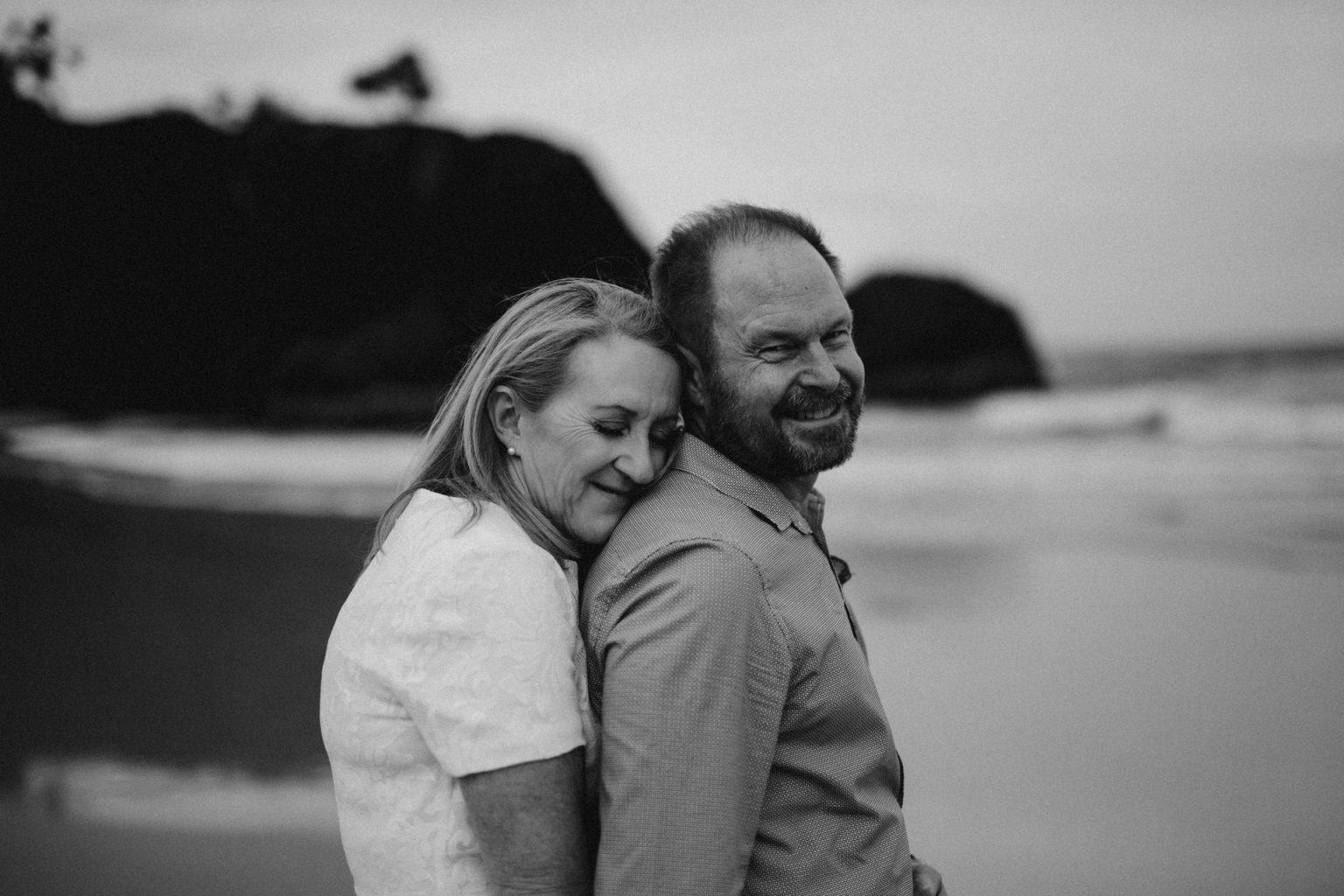 bride and groom on beach at Fingal head  hug