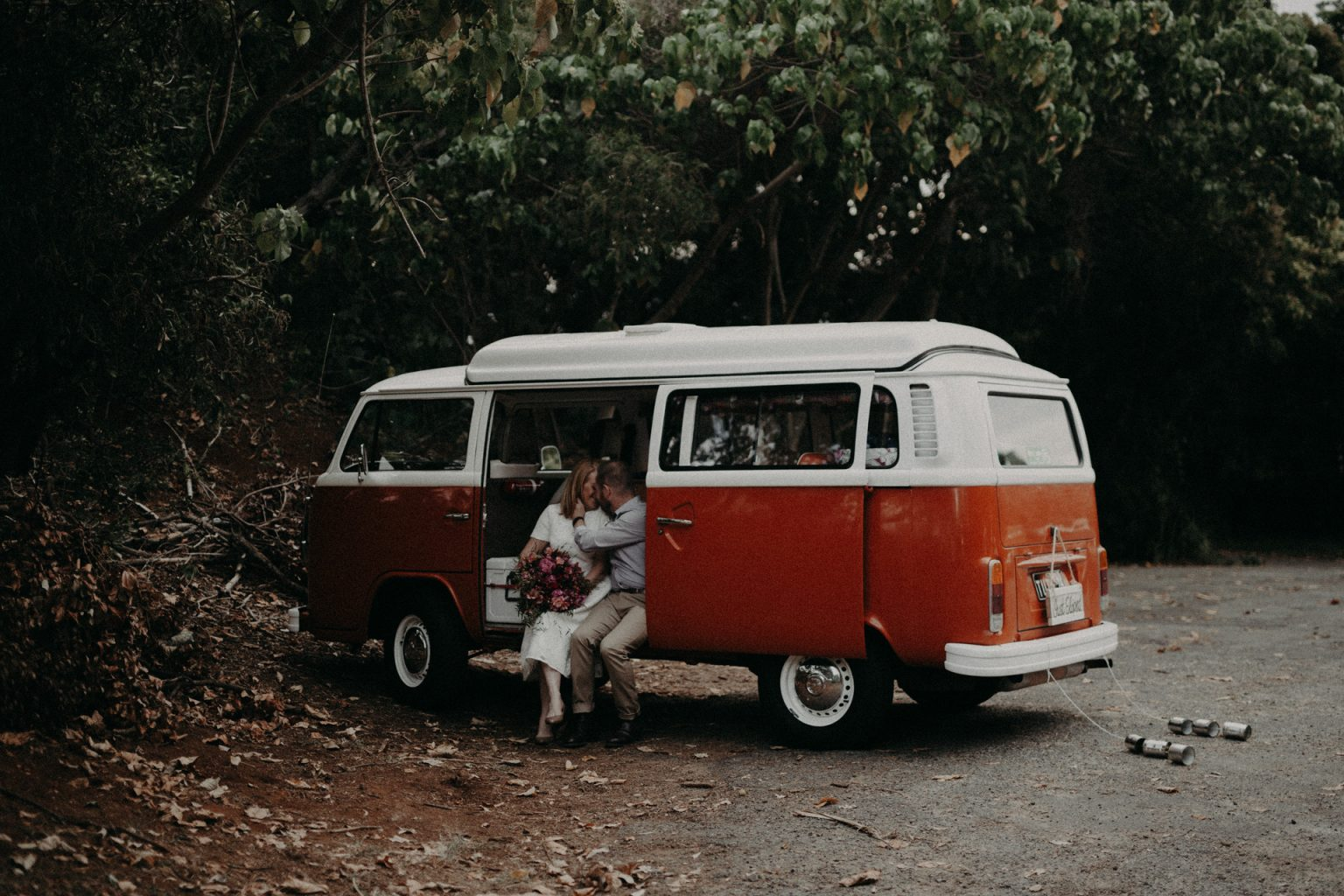 bride and groom in kombi van Fingal head elopement