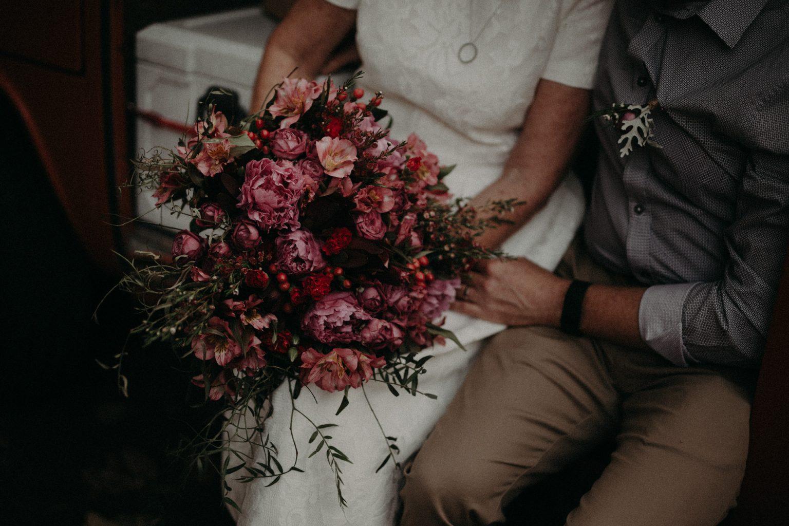 bride and groom in kombi van Fingal head elopement flower bouquet