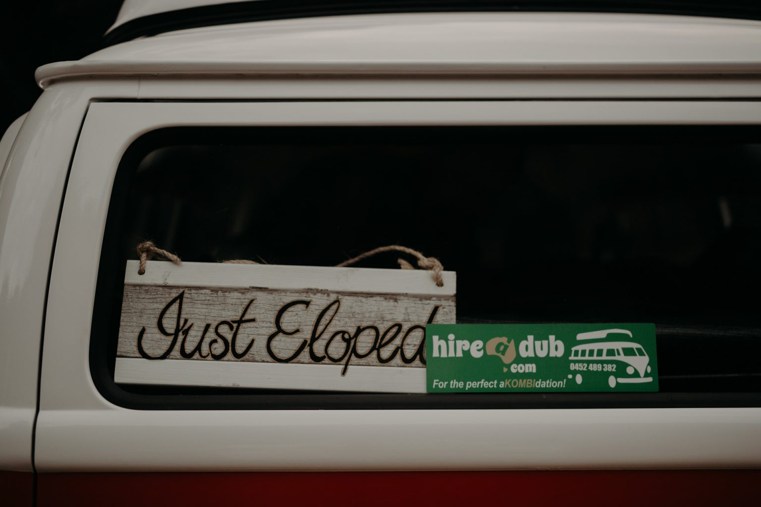 bride and groom in kombi van Fingal head elopement just eloped sticker