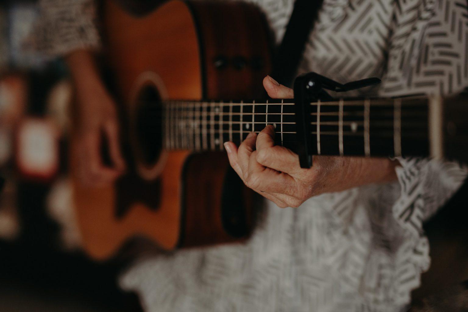 singing teacher with guitar brisbane music studio