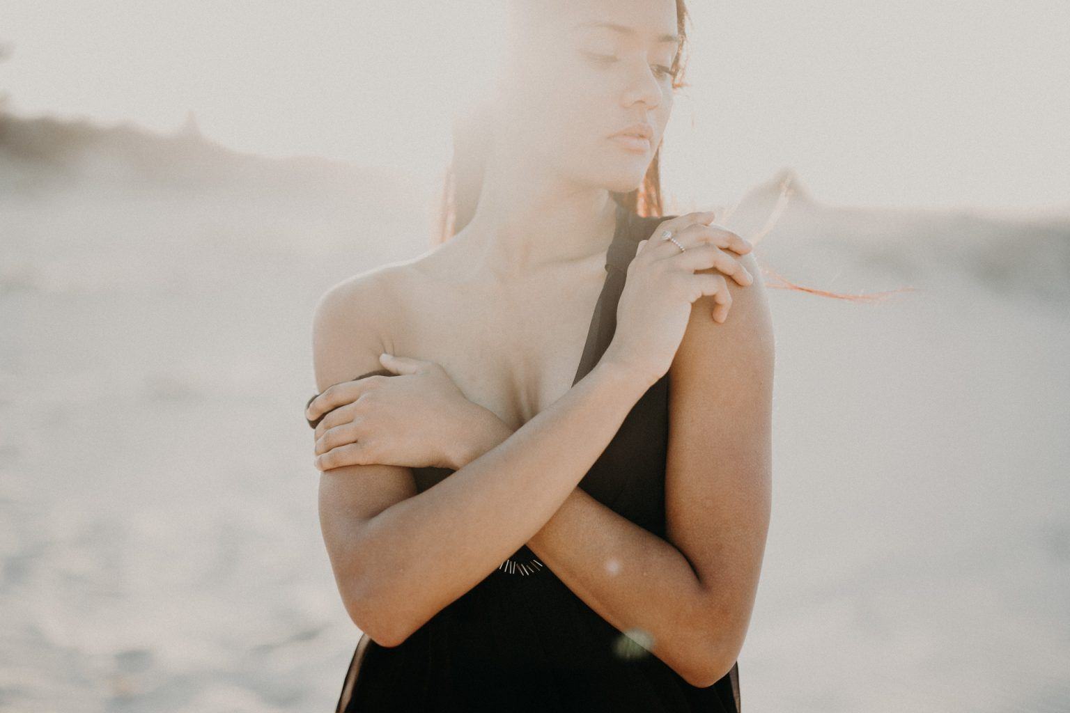 woman on beach in sun glow